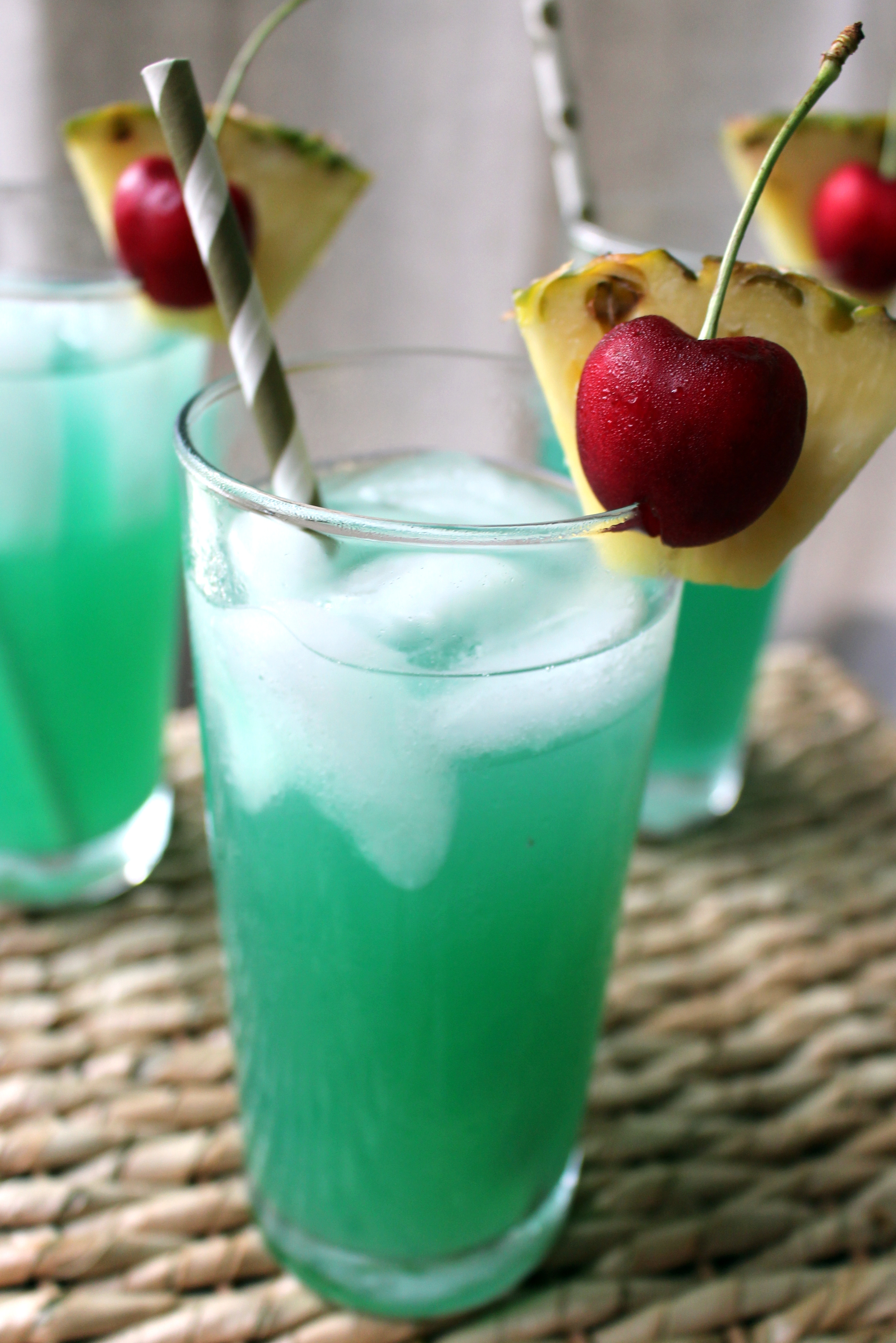 Fourth of July Drink with coconut rum, blue curacao, and pineapple juice.