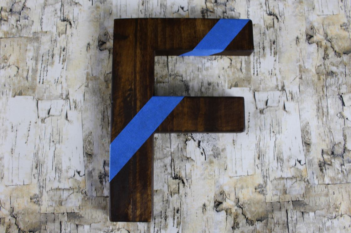 Creating a color block letter using stain and paint.