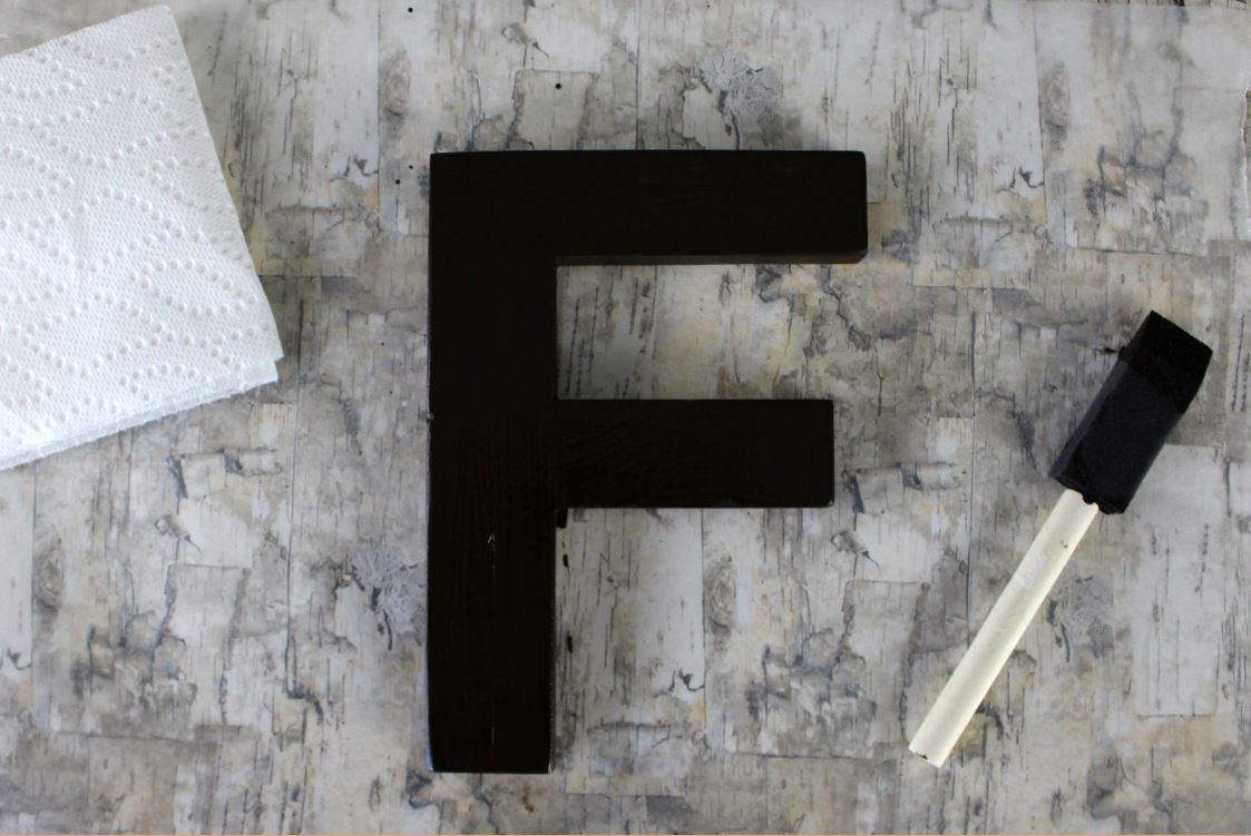 For darker results when staining a wooden letter, allow the stain to sit longer before wiping off the excess stain.