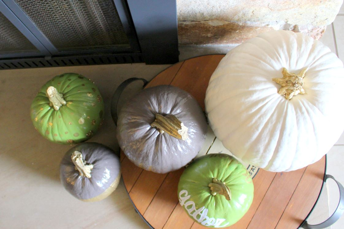 Painting fake pumpkins to use year after year