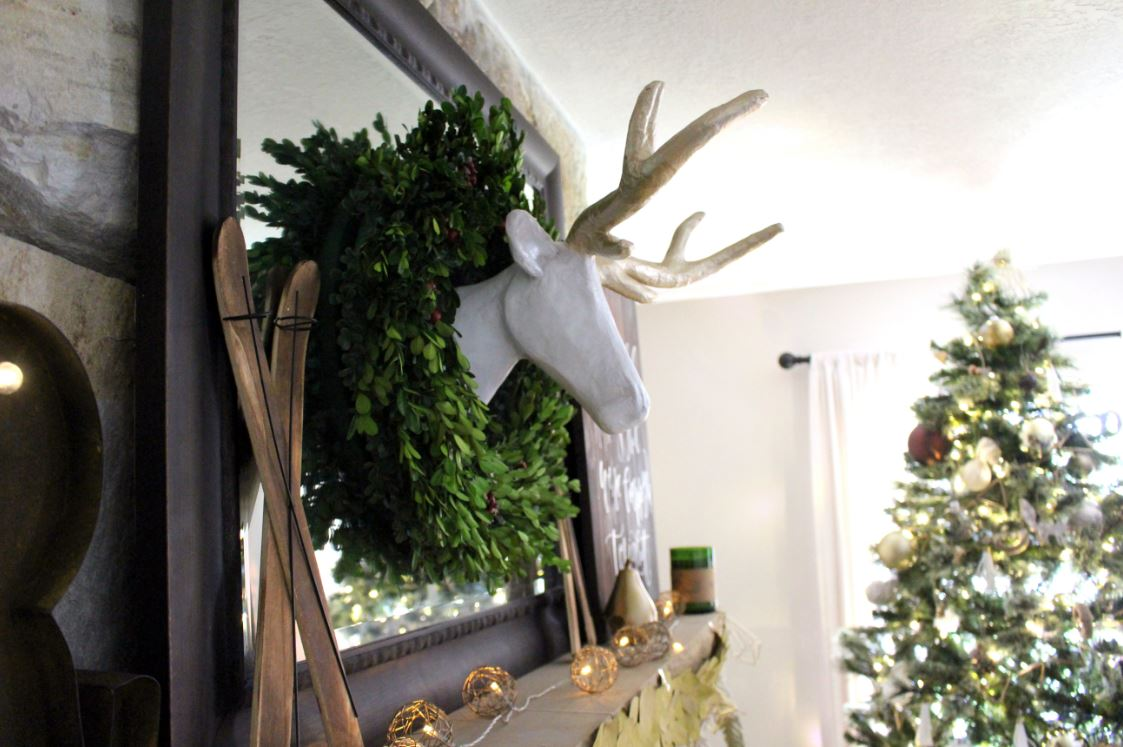 Deer head inside a boxwood wreath
