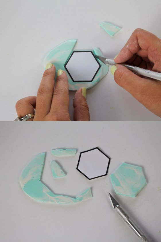 Using the hexagon stencil to cut out clay hexagons.