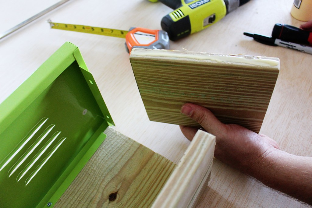 Applying wood glue for extra hold with DIY Planter Boxes