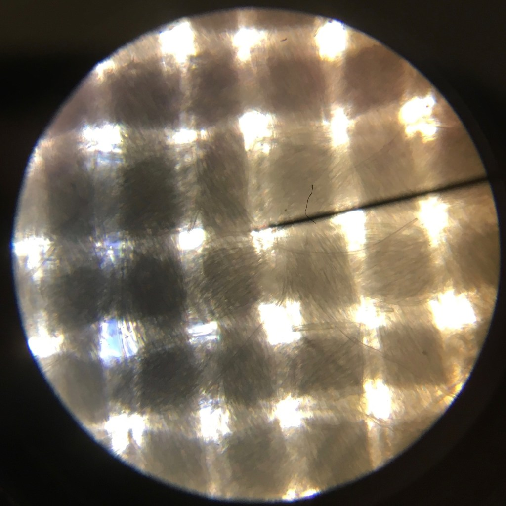 Microscope image of lilac polkadot viscose.