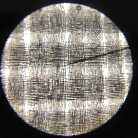 Microscope image of non-stretchy lining fabric.