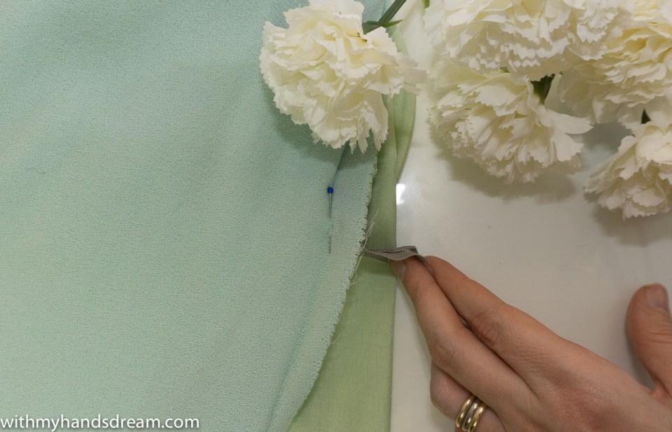 Finishing the seam under the zipper.
