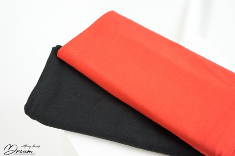 Autumn fabrics: Black sweatshirting and red jersey.