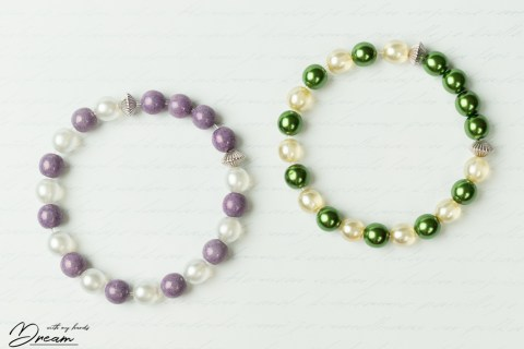 """Two bracelets: """"Orvokki"""" and """"Metsätähti""""."""