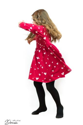 The red organic jersey dress I designed for my daughter can also be twirled in!