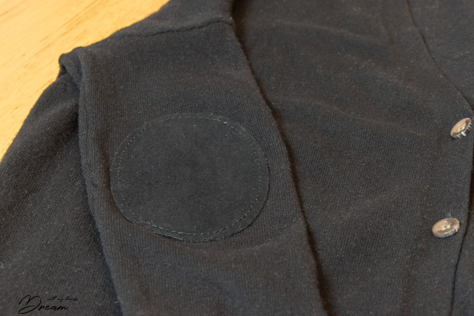 Mending a cardigan with some elbow patches.