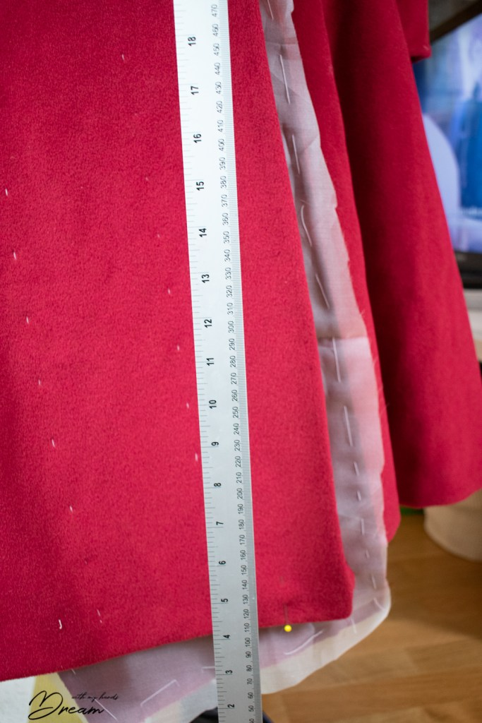 Straightening the coat front to hang right.