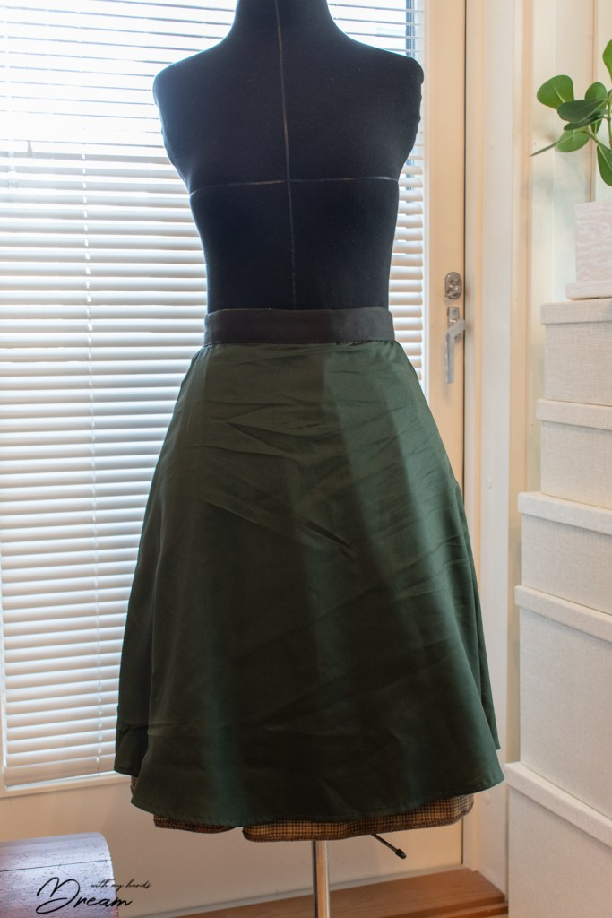 The skirt from the inside with the lining and the Petersham ribbon from the couture waistband visible.