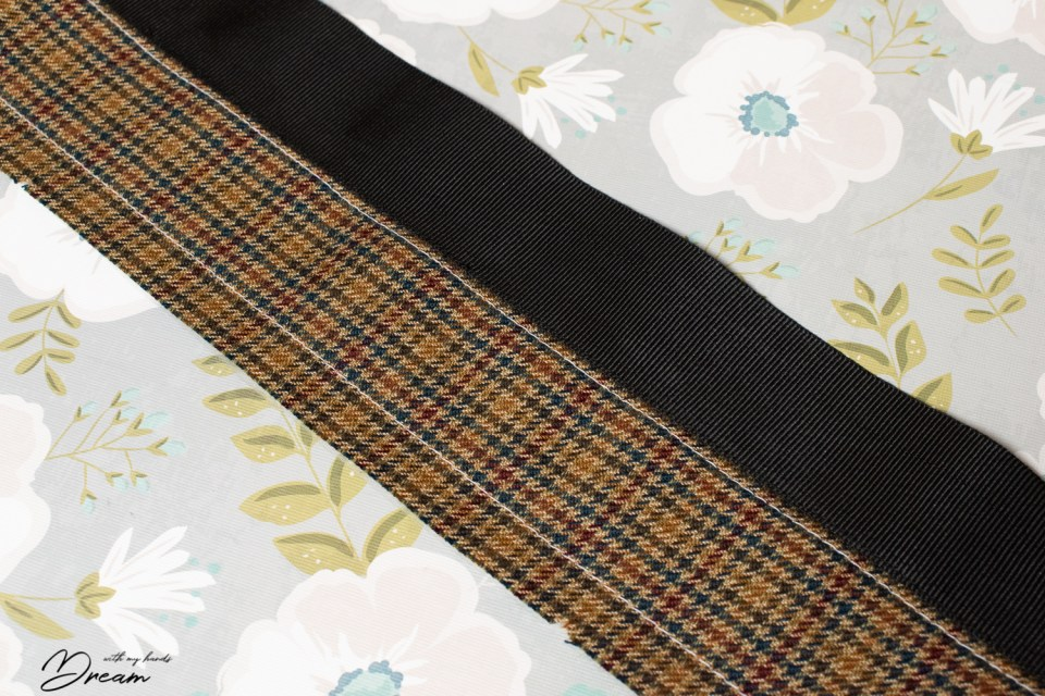 Fastening the Petersham ribbon to the couture waistband.