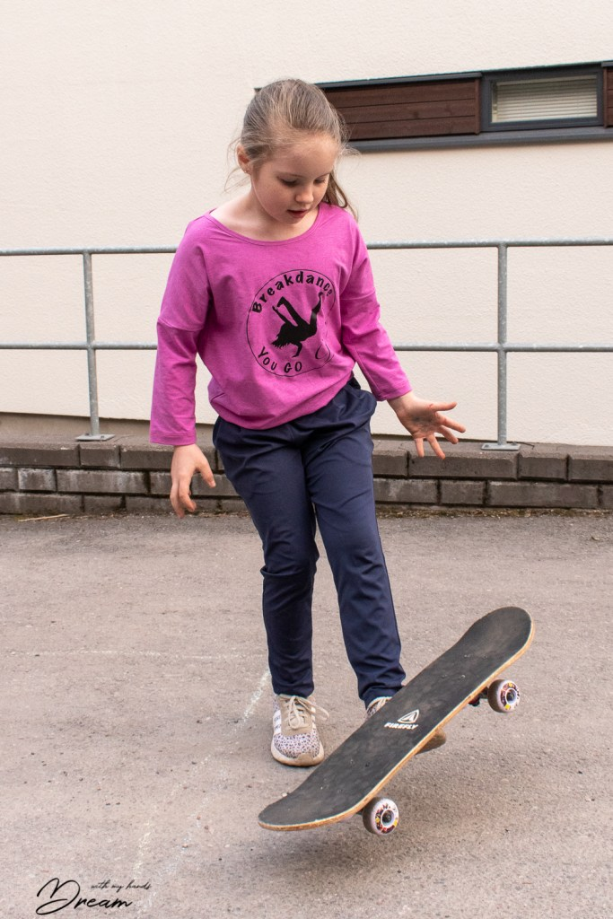 S in her new pink sports teeshirt with the vinyl print.