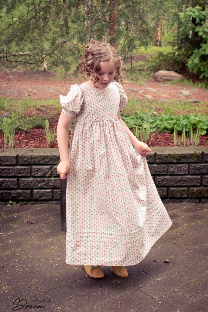 Girl's Regency dress by Sense and Sensibility patterns. Front view.