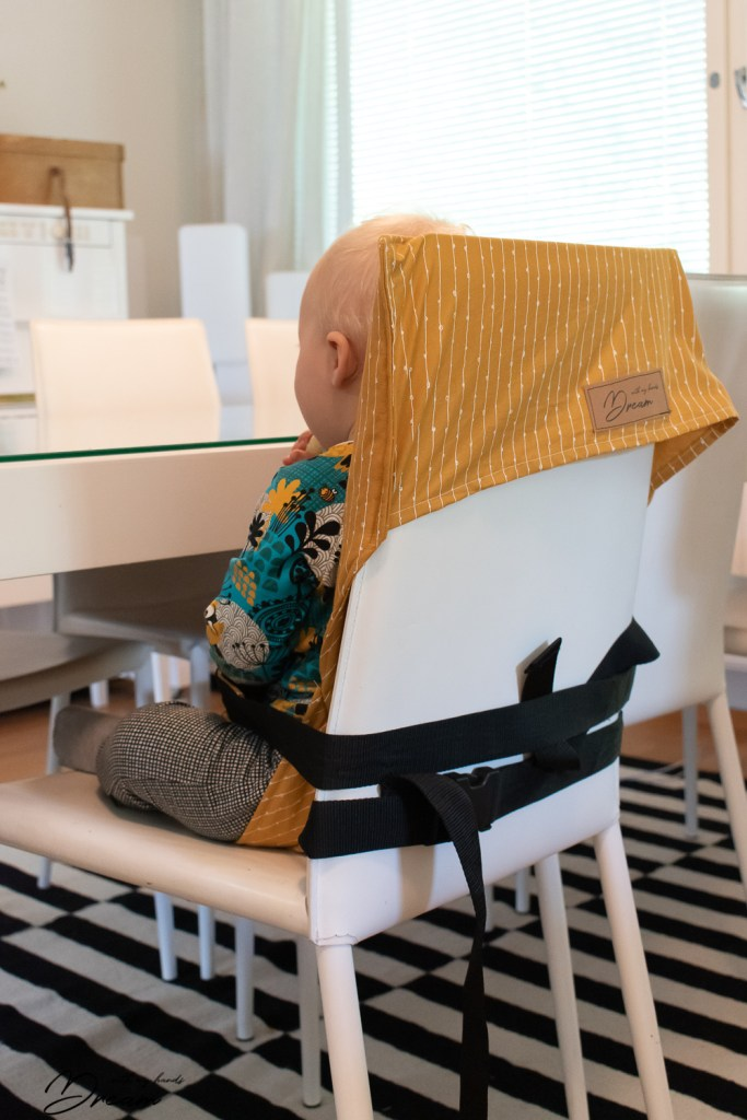 Fastening the travel high chair.