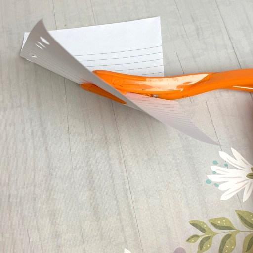 Using the Fiskars paper cutter.