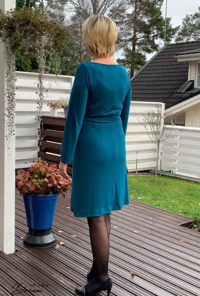 Petrol blue kielo dress from the back view.