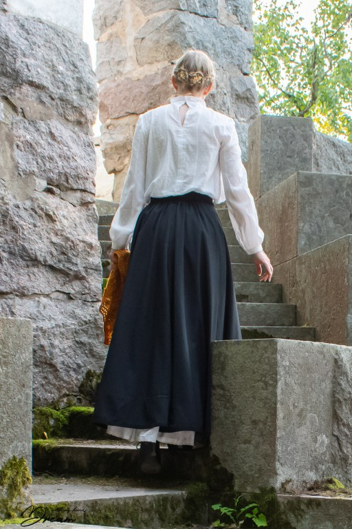 Going up the stairs. Skirt back showing.