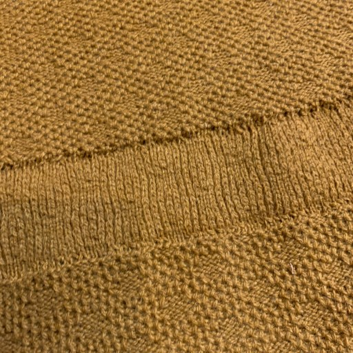 The waistband with the kitchener stitch.