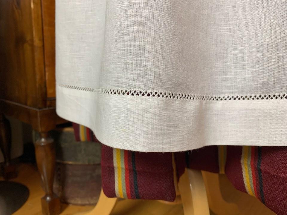 Drawn thread embroidered hem.
