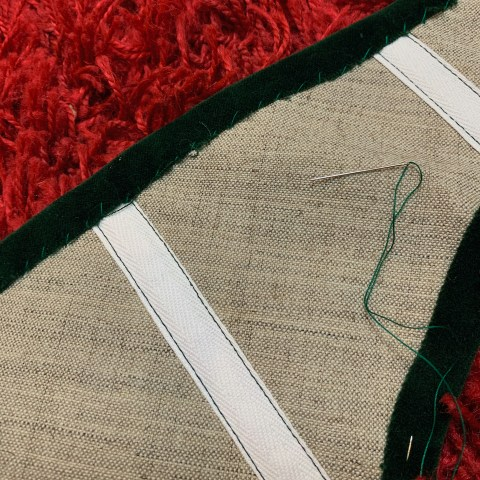 Sewing on the outer fabric to the belt canvas.