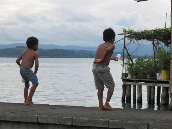 Two neighboring kids fishing like MacGyver would.
