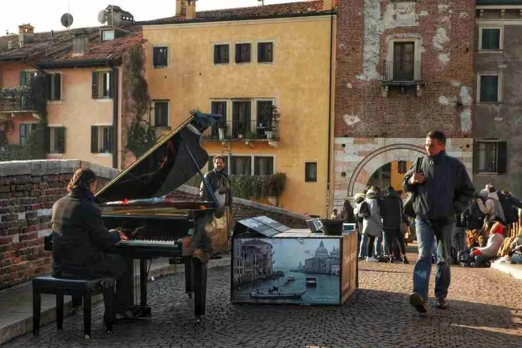 Piano player on Ponte Pietra in Verona