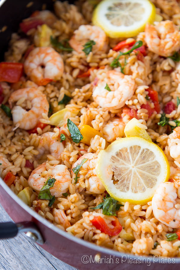 This One Pot Shrimp and Veggie Orzo is the perfect weeknight meal. Lots of crisp veggies, succulent shrimp, fresh basil and a secret spice make this meal a favorite in our family!