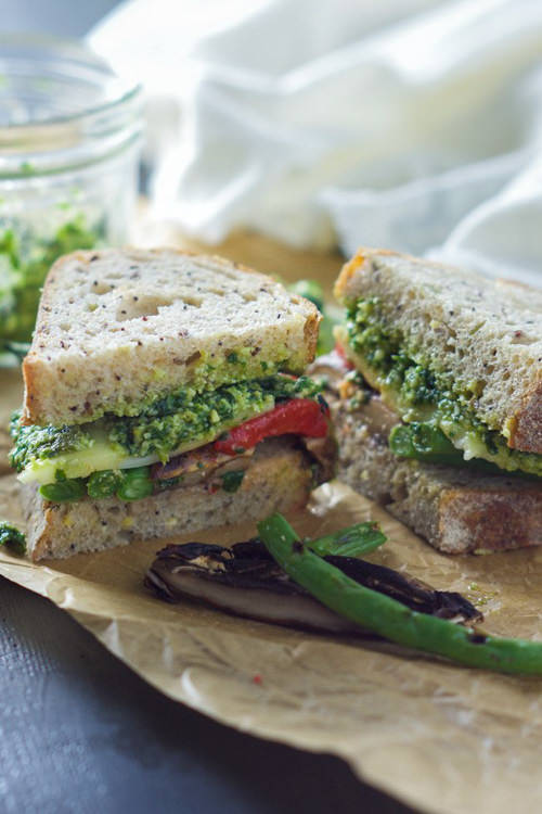 A sandwich that is full of flavor! Farmers Market Roasted Vegetable Sandwich with Skinny Pesto is loaded with fresh vegetables creamy provolone and layered with a healthy pesto sauce!