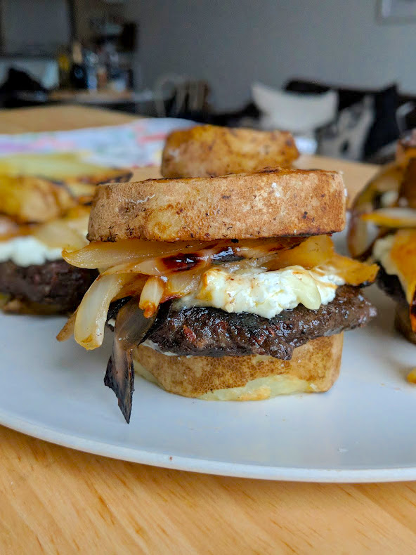 Mushroom Veggie burger with goat cheese and caramelized onions on two potato buns