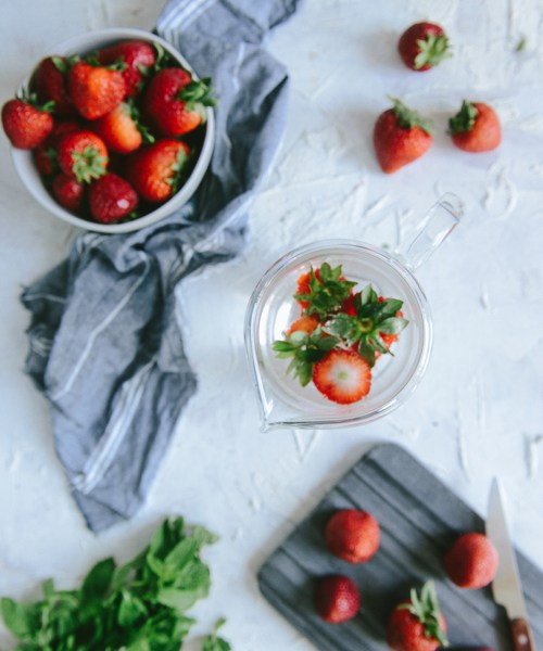 Strawberry Detox Water To Waste Less and Drink More // www.WithTheGrains.com