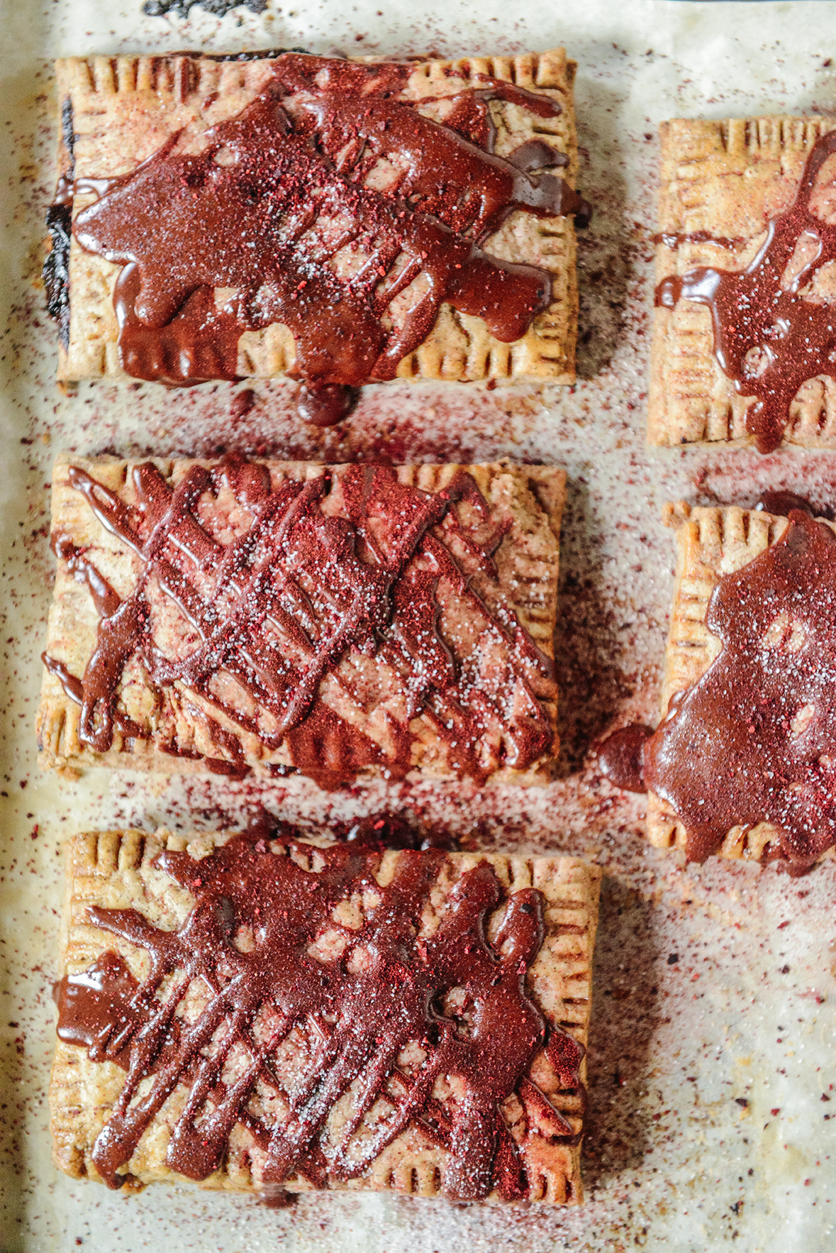 Homemade Cherry Pop Tart w/ Dark Chocolate Drizzle & Rose Petals // www.WithTheGrains.com