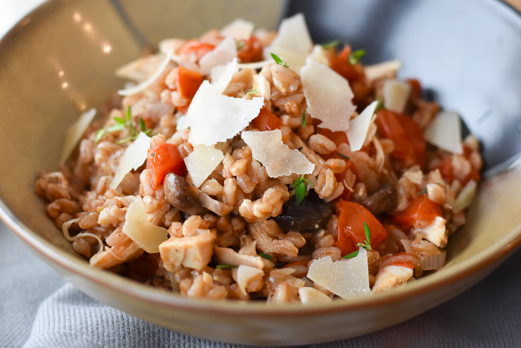A close up of One Pot Farro with Chicken and Tomatoes