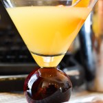 Orange Vanilla Martini Close up on Newspaper