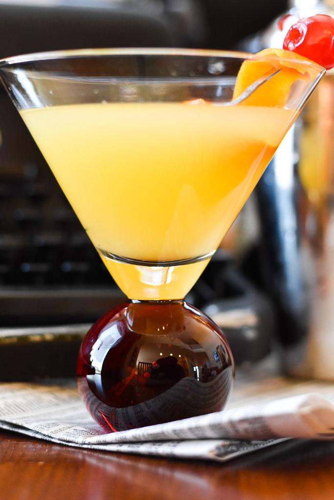 Orange Vanilla Martini Close up on Newspaper