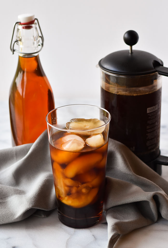 Caramel Coffee Syrup, a glass of cold press and a french press
