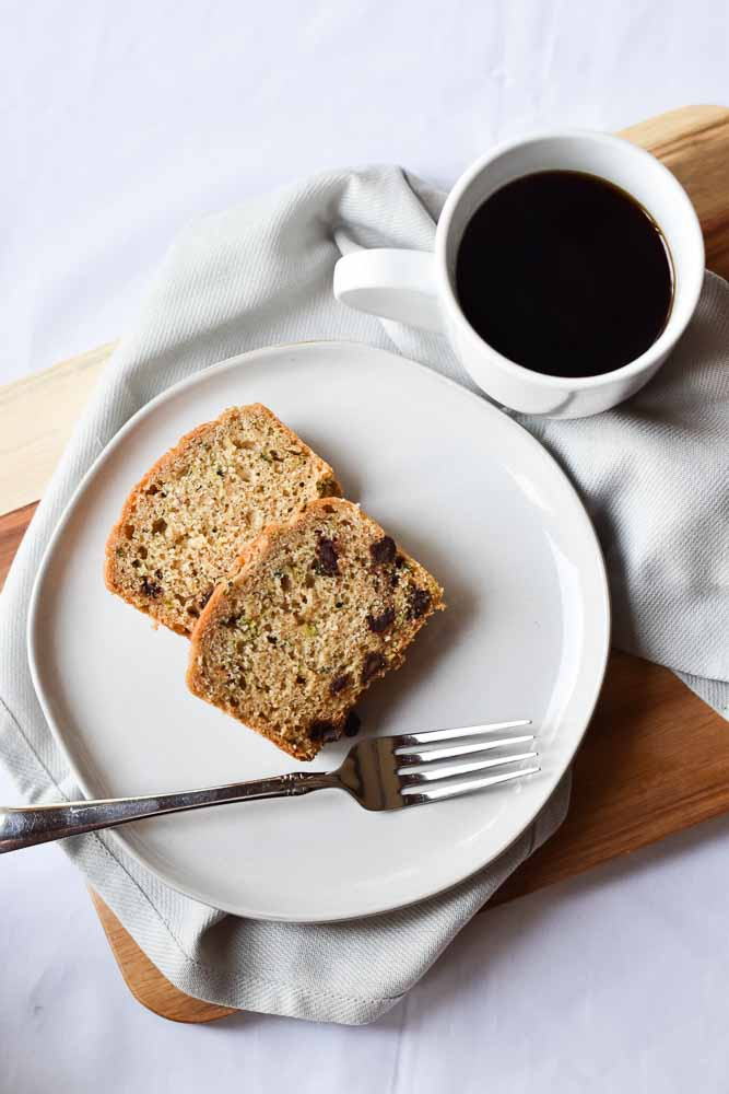 Chocolate Chip Zucchini Bread on a plate with coffee