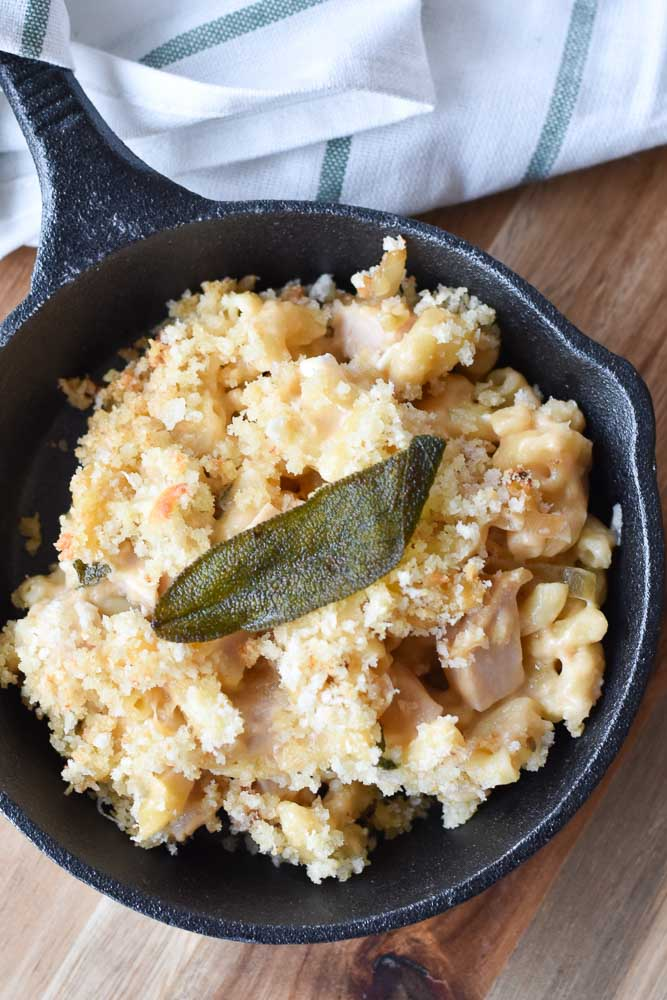 Baked Macaroni and Cheese with Turkey and Caramelized Onions in a cast iron skillet