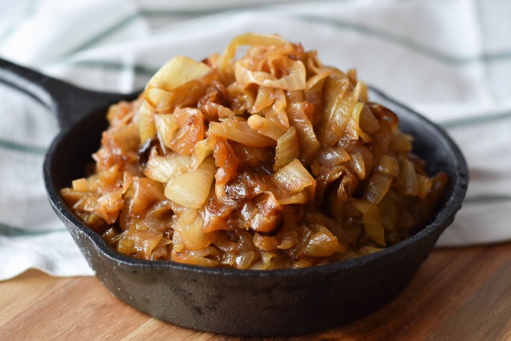 How to Make Caramelized Onions heaped up in a cast iron skillet