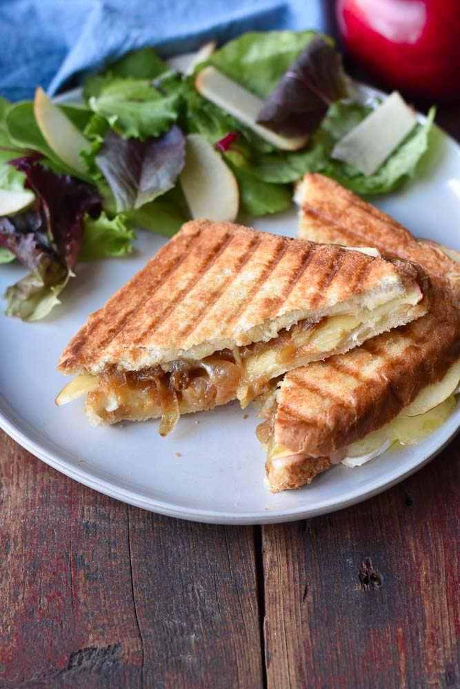Caramelized Onion, Apple, and Brie Grilled Cheese Sandwiches on a plate