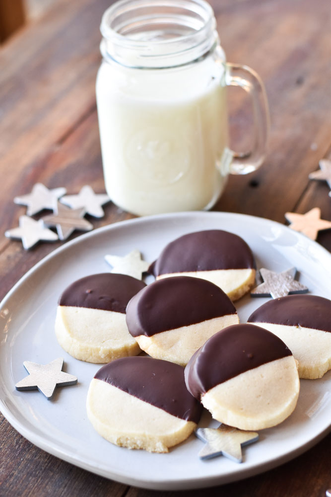 Dark Chocolate Dipped Almond Shortbread Cookies with a glass of milk