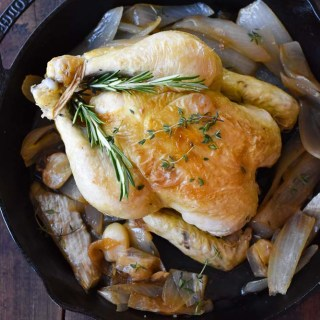 Dutch Oven Roasted Chicken in a cast iron skillet