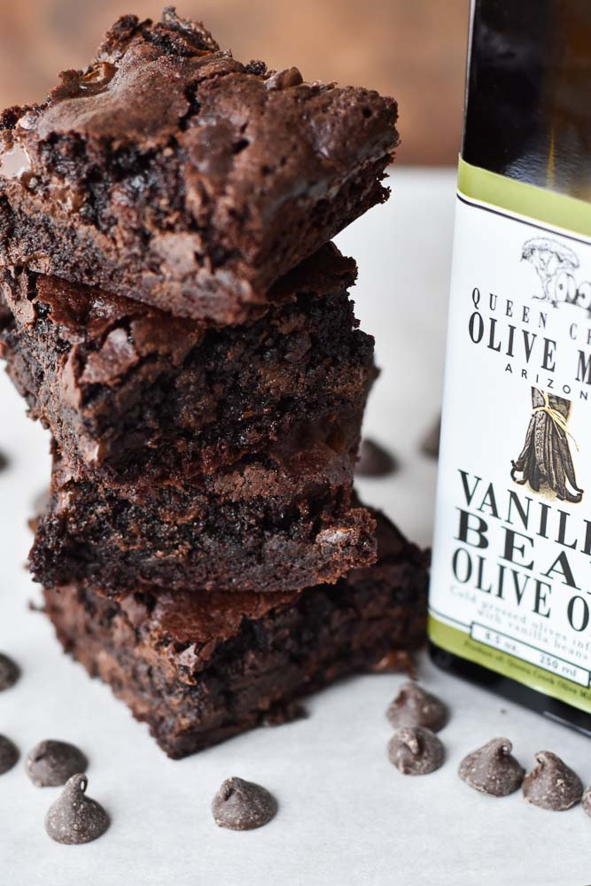 Double Chocolate Olive Oil Brownies in a stack with Queen Creek Olive Oil