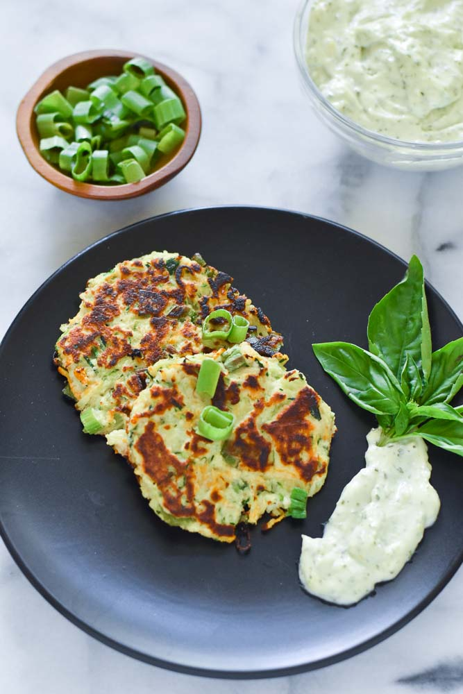 Carrot Zucchini Fritters on a plate with a side of Lemon Basil Aioli