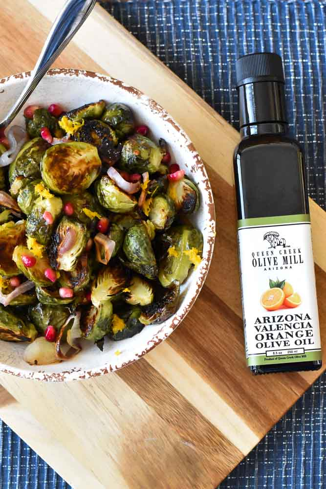 Citrus Kissed Brussels Sprouts with a bottle of Queen Creek Orange Olive Oil