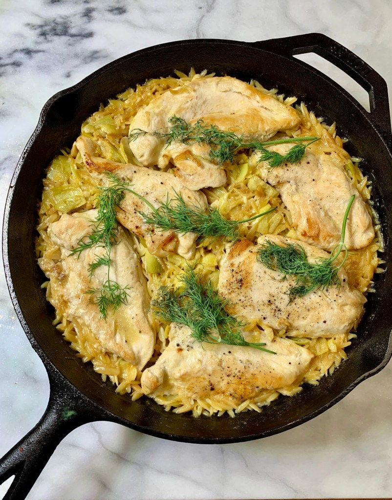 White wine braised Chicken and Orzo with artichokes.  The recipes I have on repeat.