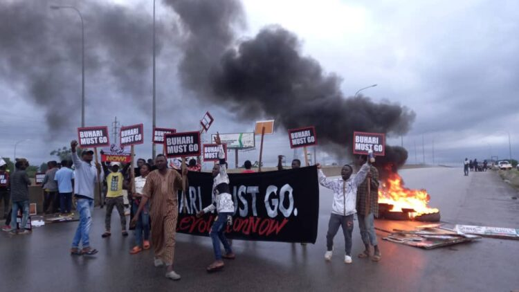 Police disperse #BuhariMustGo protesters with teargas in Abuja