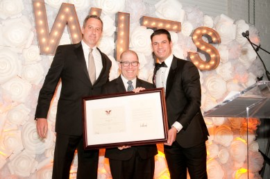 Ron Sonenthal accepting the award on behalf of deloitte at the WITS Gala