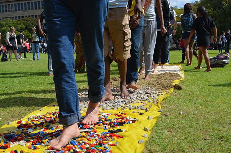 "SHOES FOR WHO?: Students take on the ""Path Without Shoes"" to understand what it is like to live without shoes. Photo: Pheladi Sethusa"